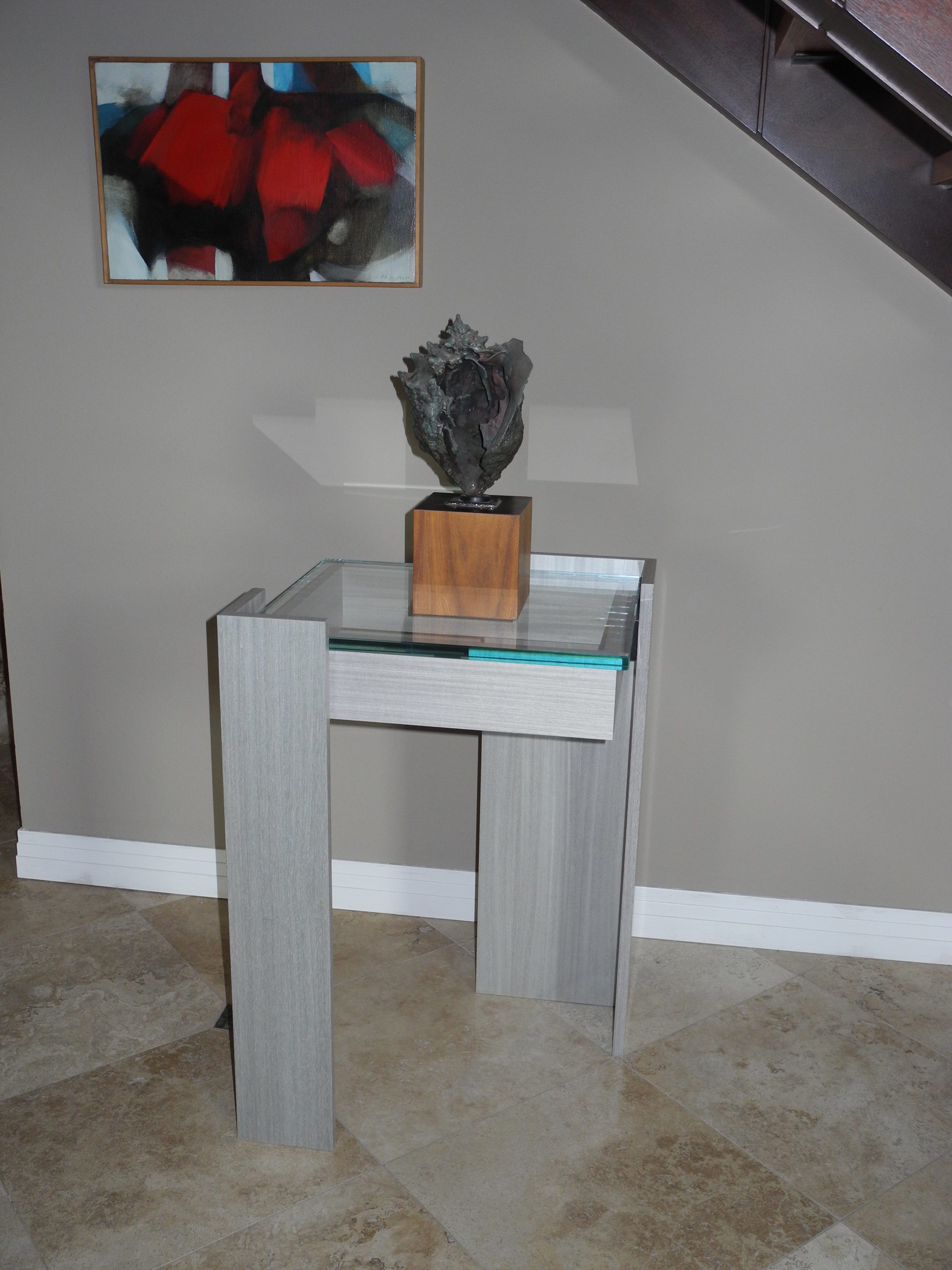 koto wood table tall with glass top and sculpture